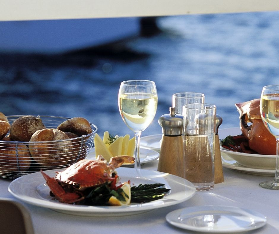 Waterfront dining. Meal with wine.