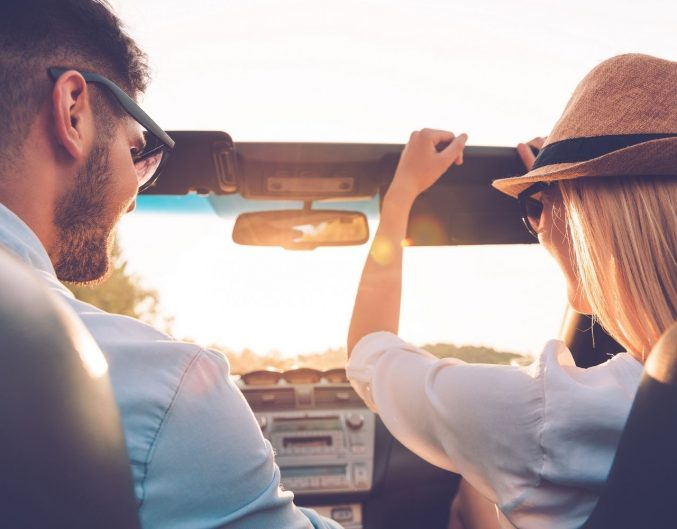 Man and woman on a road trip.