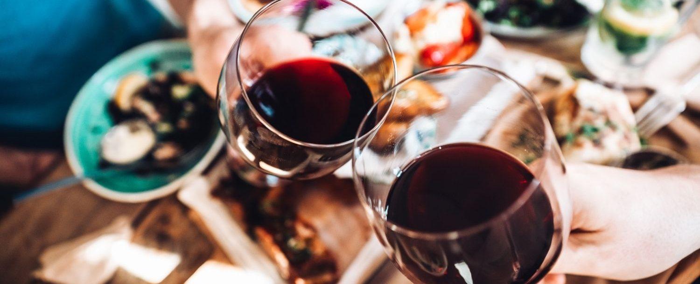 People toasting wine glasses.