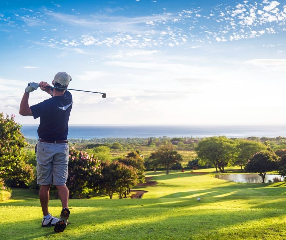 Man playing golf with an ocean view